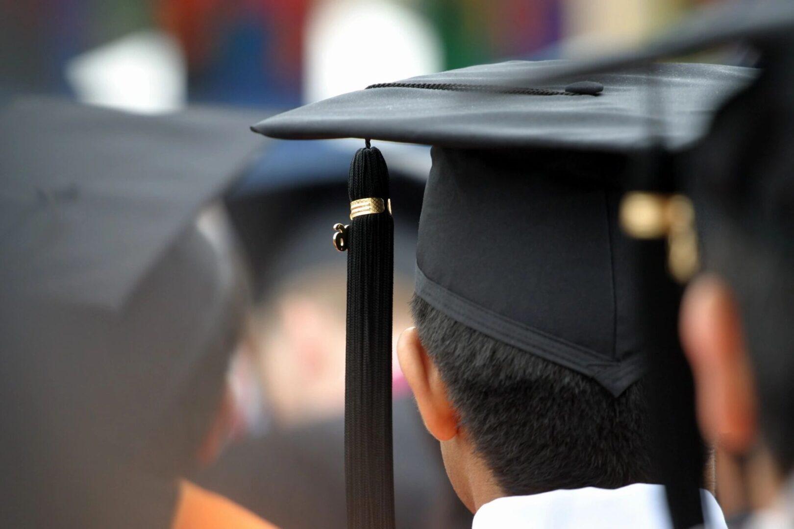 A person wearing a black graduation cap